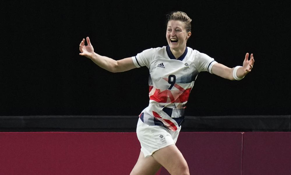 Britain's Ellen White celebrates scoring her side's opening goal during a women's soccer match against Japan at the 2020 Summer Olympics, Saturday, July 24, 2021, in Sapporo, Japan. (AP Photo/Silvia Izquierdo)