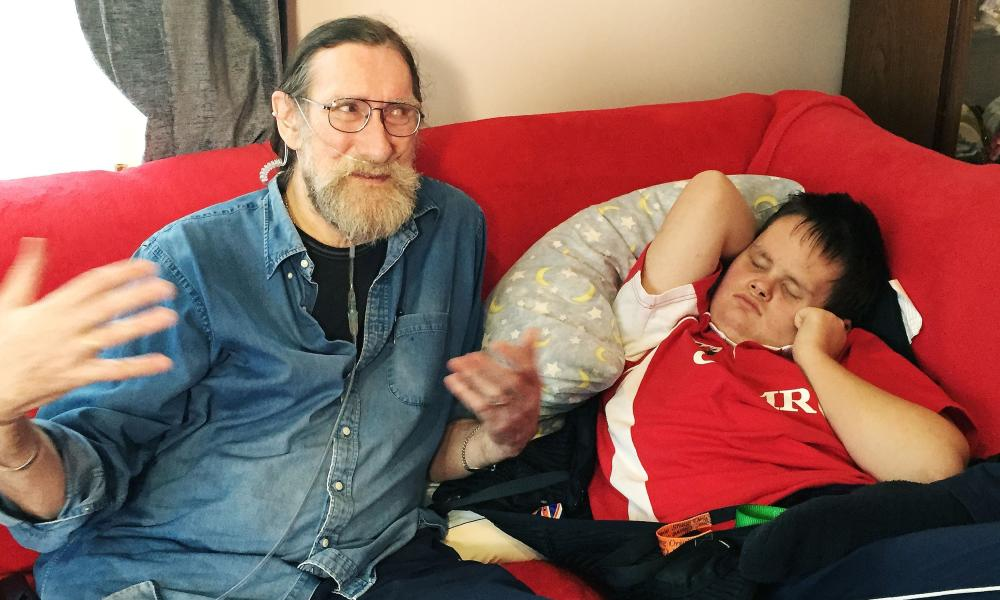 Paul Rutherford with his disabled grandson Warren at their home in Pembrokeshire