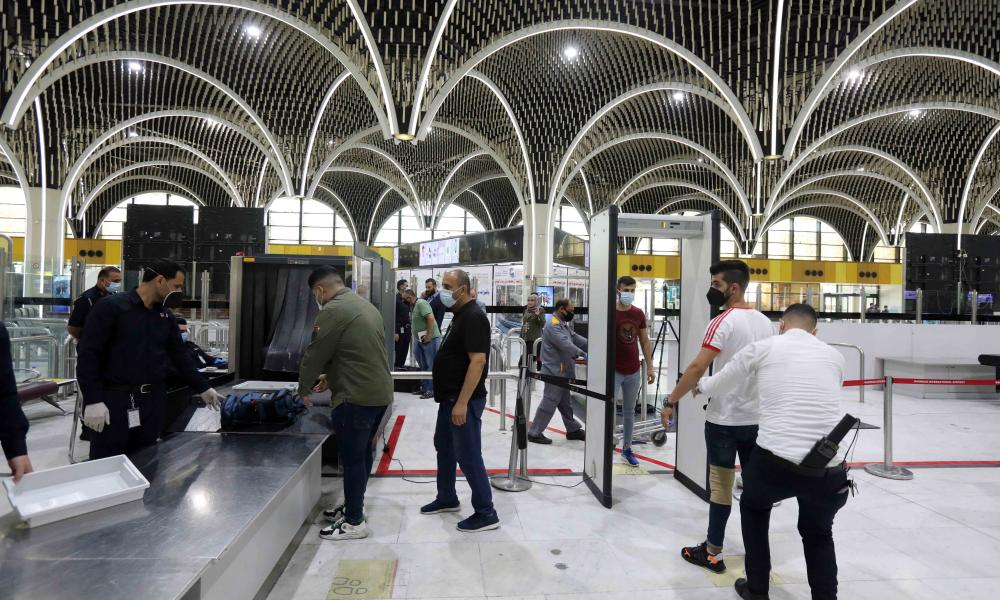 Passengers go through security check at Baghdad International Airport in Iraq, July 23, 2020. The Iraqi Civil Aviation Authority resumed regular international flights, even as the total number of Covid-19 infections in the country reached 102,226.