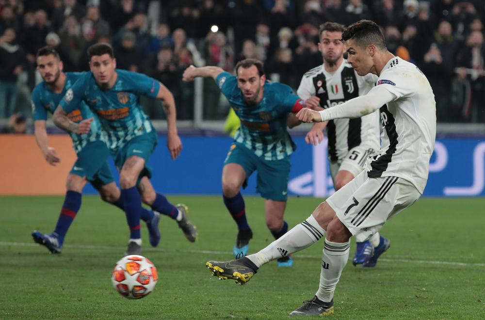 Cristiano Ronaldo of Juventus fires home from the penalty spot.