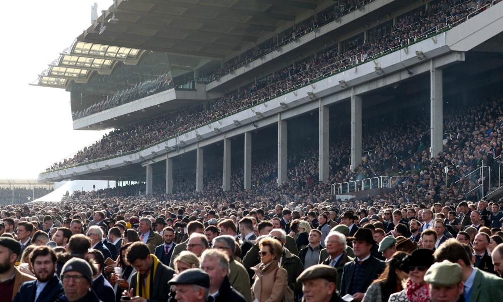 Crowds in the stands during day four of the Cheltenham Festival at Cheltenham Racecourse.