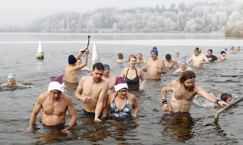 Swimmers come out of the cold water after the traditional New Year's Eve swimming in lake Moossee at Moosseedorf, Switzerland.
