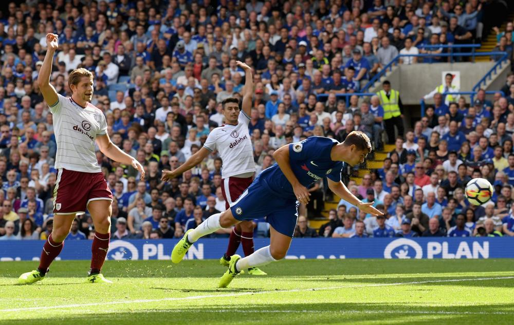 Alvaro Morata dives to head the ball into the back of the net.