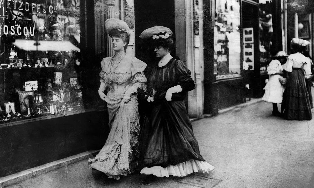 Two elegant ladies walking in the street  in Paris 1905