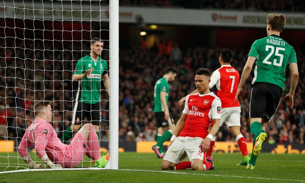 Arsenal's Kieran Gibbs looks dejected after his miss.