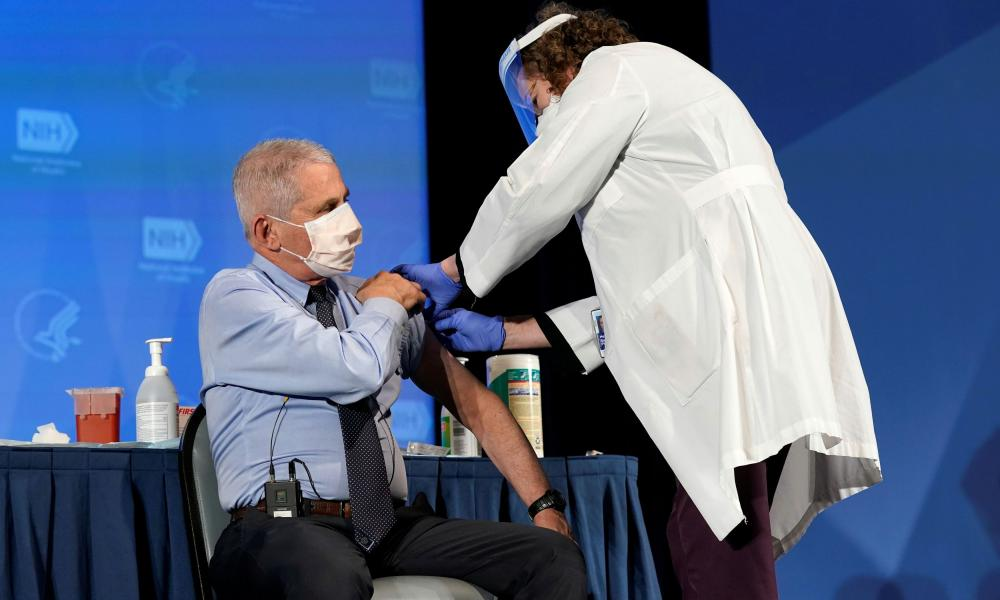 Anthony Fauci, director of the National Institute of Allergy and Infectious Diseases, receives his first dose of the new Moderna vaccine at the National Institutes of Health, in Bethesda, US