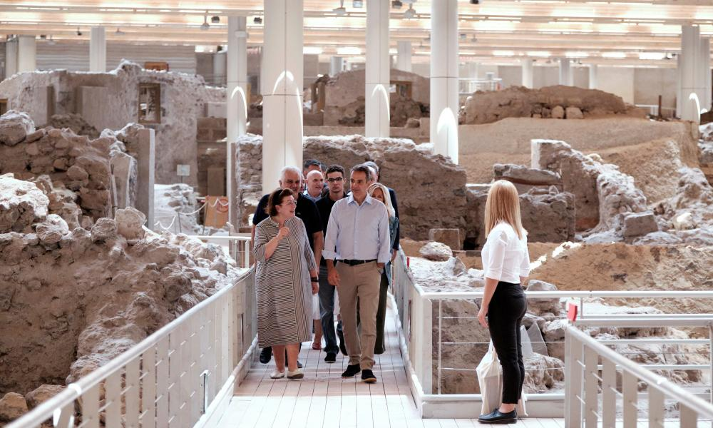 Greek prime minister Kyriakos Mitsotakis (R) visiting the archaeological site of Akrotiri on Santorini Island, on Saturday.