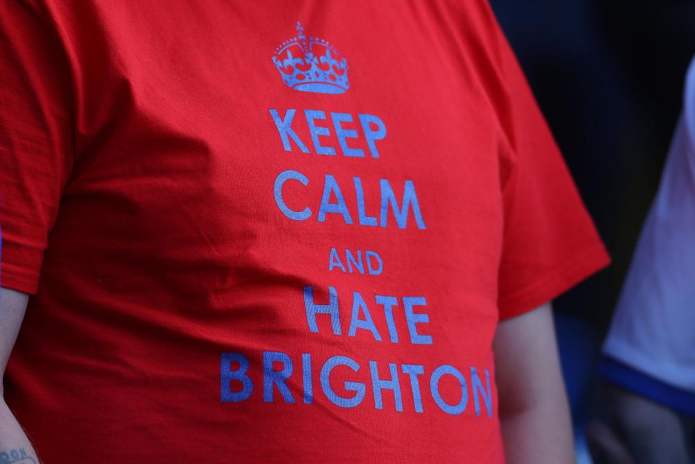 A Crystal Palace fan with a t-shirt saying 'Keep calm and hate Brighton'