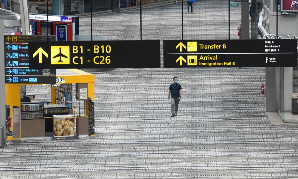 A man walks along the transit area at Changi international airport in Singapore.