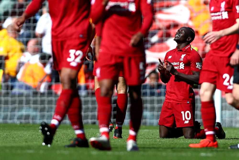Mane celebrates his second.