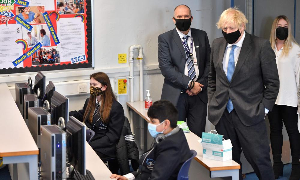 Boris Johnson speaking with pupils at Accrington academy in Accrington, Lancashire today.