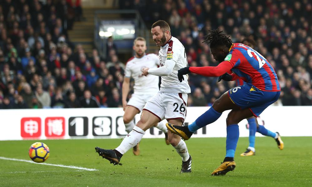 Bakary Sako of Crystal Palace scores his side's first goal as Phil Bardsley of Burnley attempts to block.