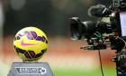 A TV camera films a close up of a Premier League football.