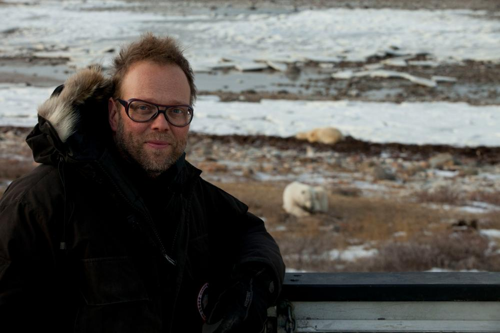 Lars Ostenfeld with a polar bear in Churchill, Hudson Bay, Canada, in November 2016