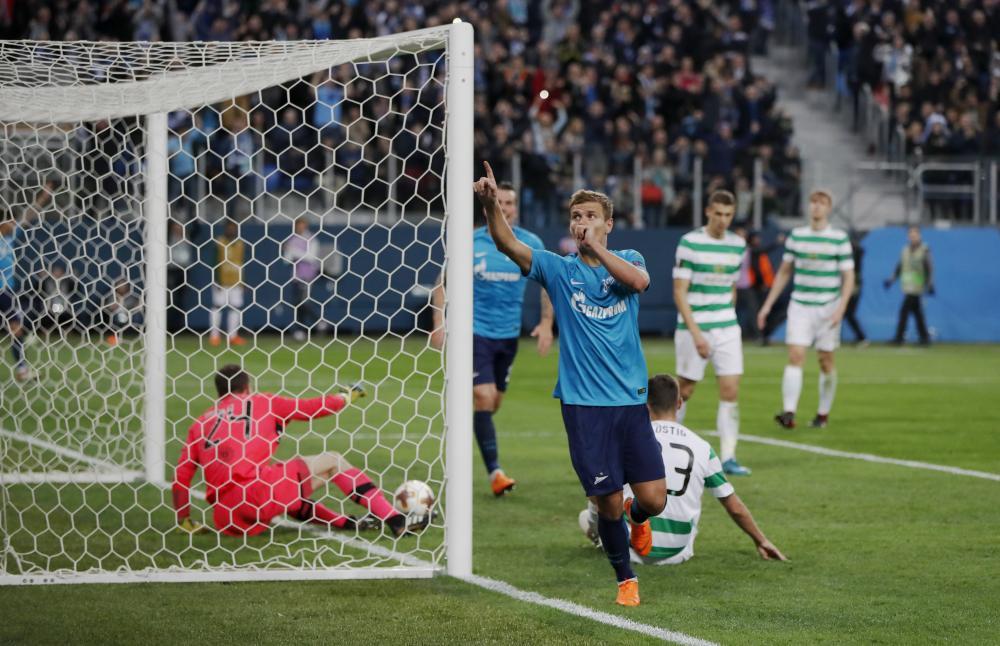 Zenit's Aleksandr Kokorin celebrates scoring the third from close range.