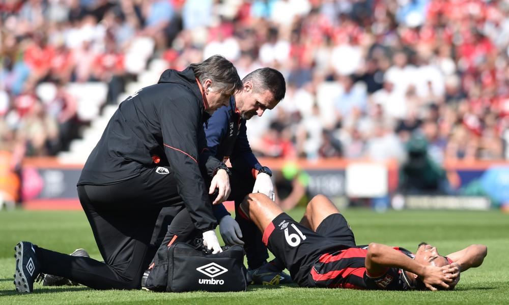 Junior Stanislas of Bournemouth goes down injured.