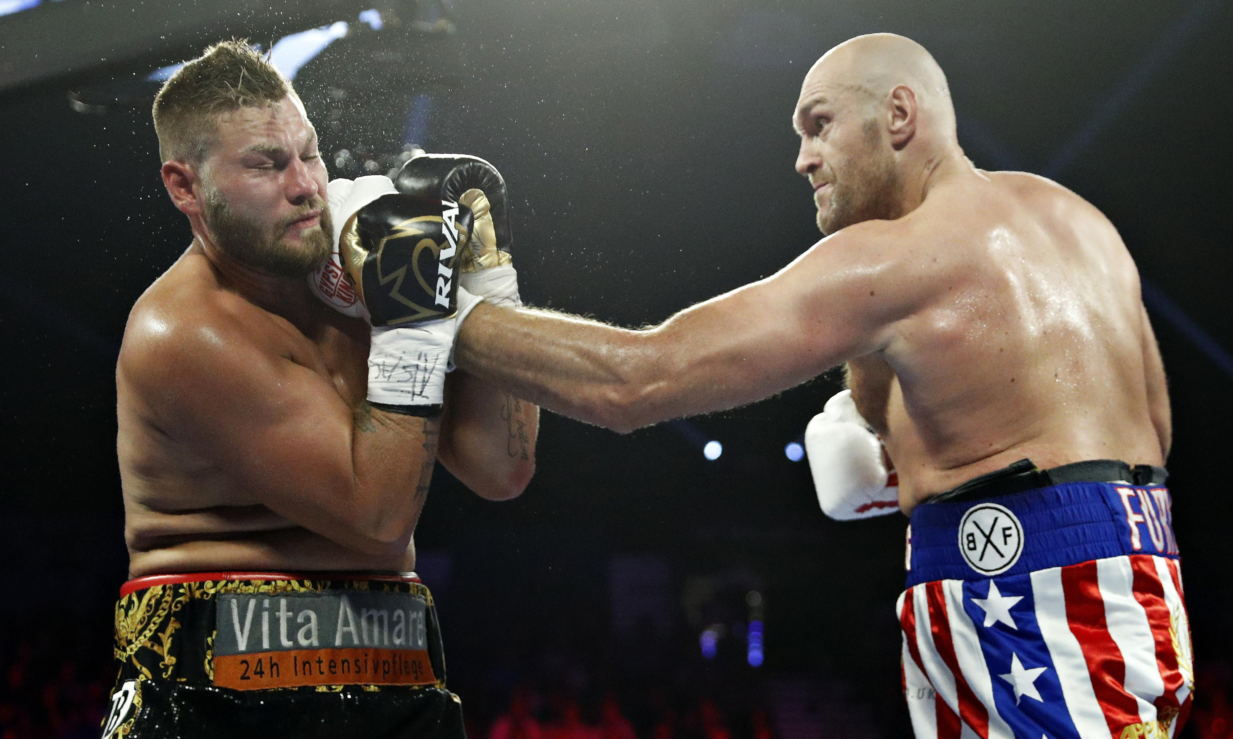 Tyson Fury puts on a show with two-round destruction of Tom Schwarz