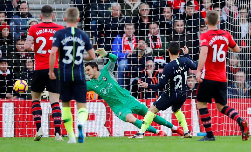 Manchester City's David Silva scores their first goal past Southampton's Alex McCarthy