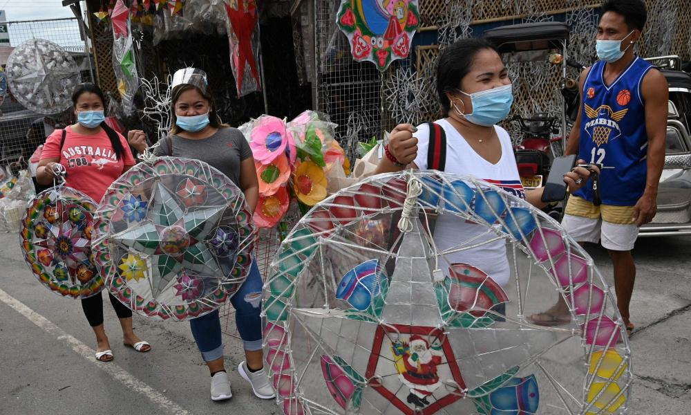 Customers walking away with newly-purchased lanterns for the festive season in San Fernando town in Pampanga province, Philippines.