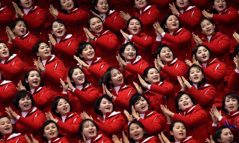 All smiles … North Korean cheerleaders at the men's 1500m short track speed skating , 10 February.