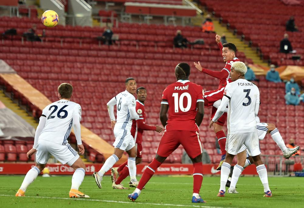 Liverpool's Roberto Firmino scores his side's third goal.