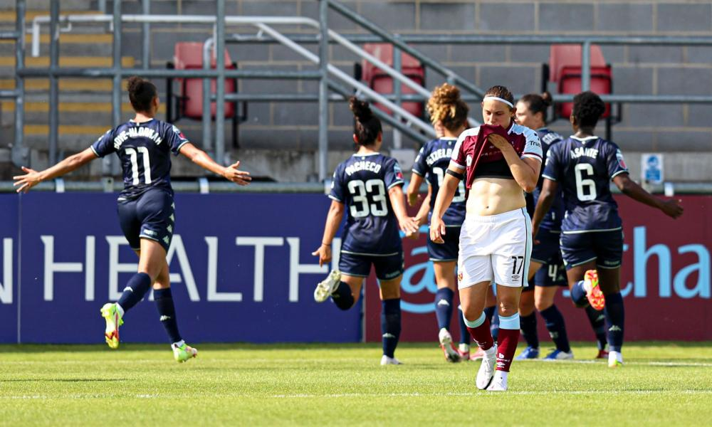 Villa players celebrate their late equaliser.