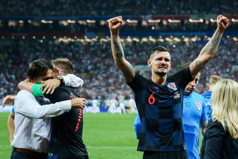 Head coach Zlatko Dalic celebrates along Ivan Rakitic and Dejan Lovren.
