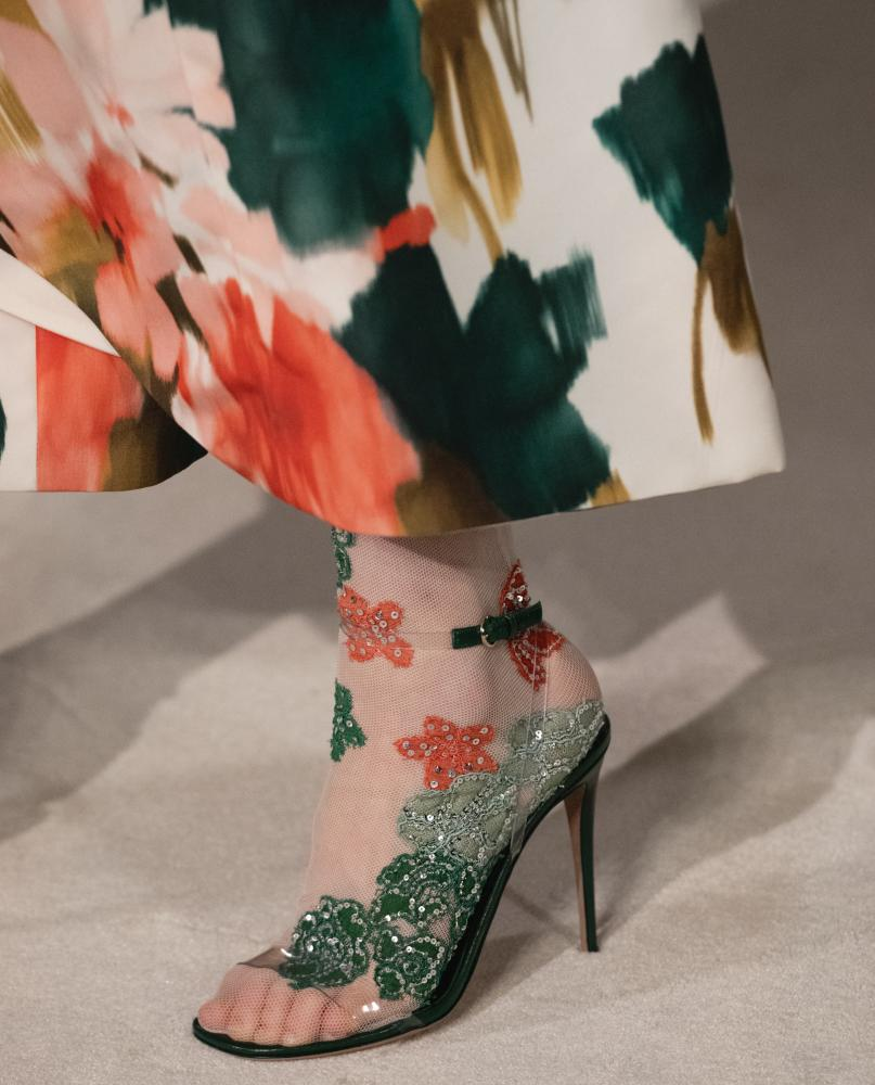 Shoe and dress hem detail at Valentino