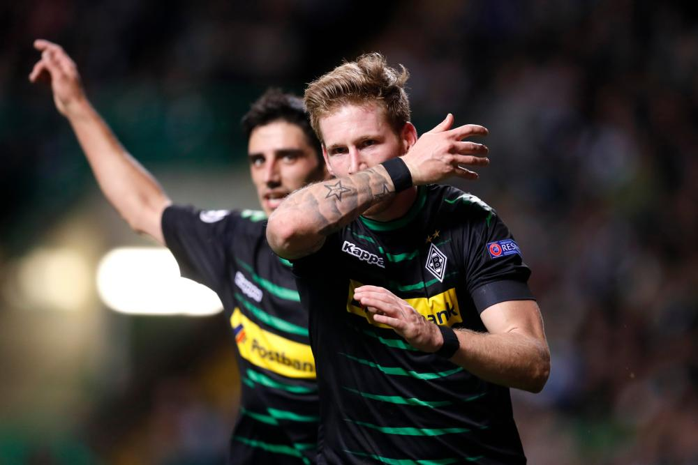 Andre Hahn celebrates after scoring in the Champions League.