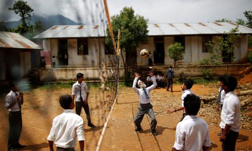 Durga Kami, 68, who is studying in the 10th grade at Shree Kala Bhairab higher secondary school, plays volleyball with friends during a break.