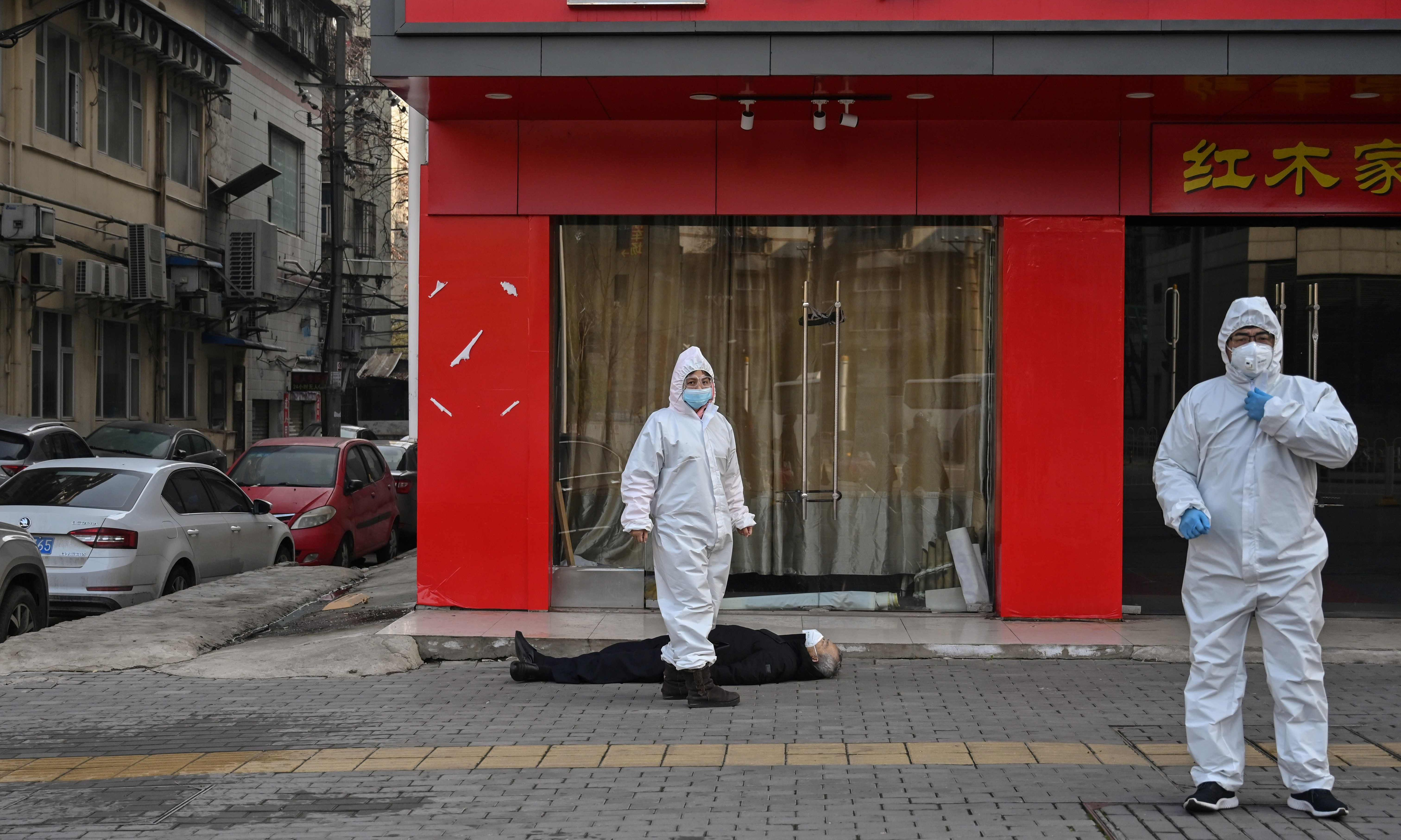 A man lies dead in the street: the image that captures the Wuhan coronavirus crisis