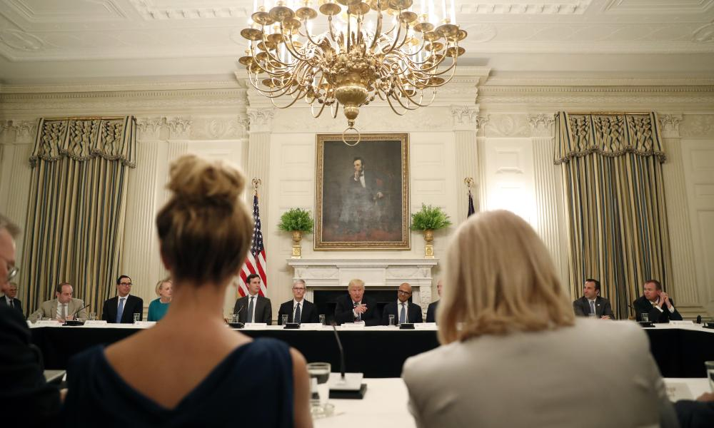 Ivanka Trump sits beside Ginni Rometty, CEO of IBM, at the roundtable in the state dining room of the White House.