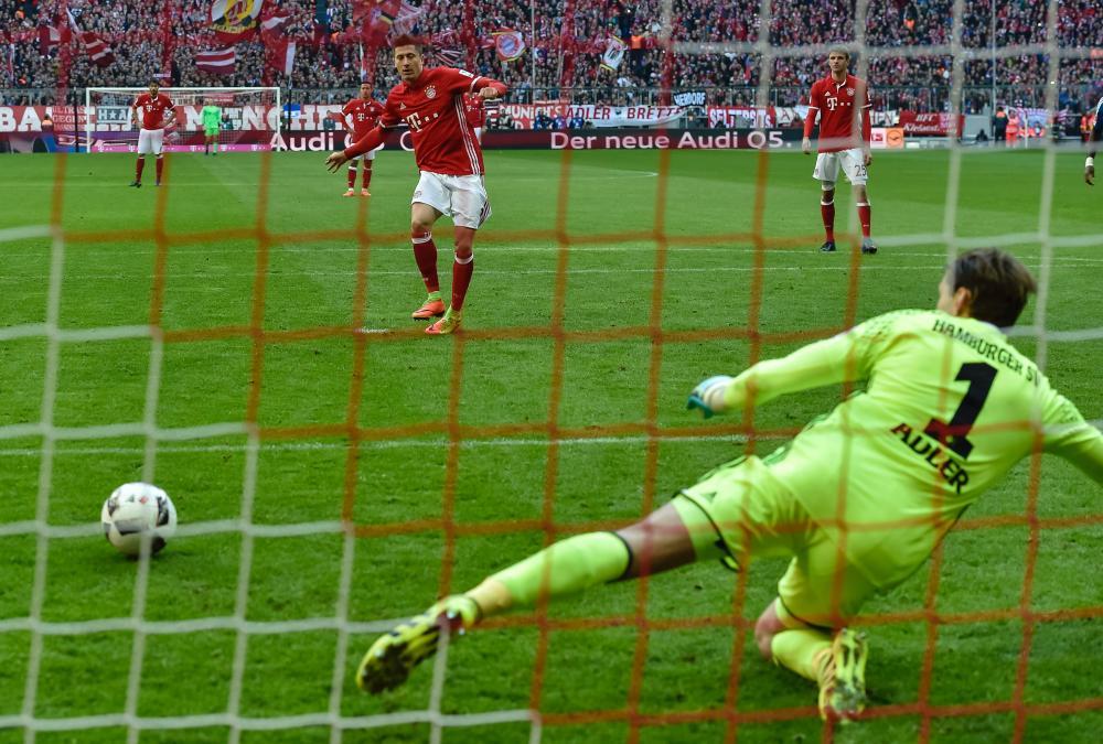 Robert Lewandowski scores from the spot during Bayern's rout.