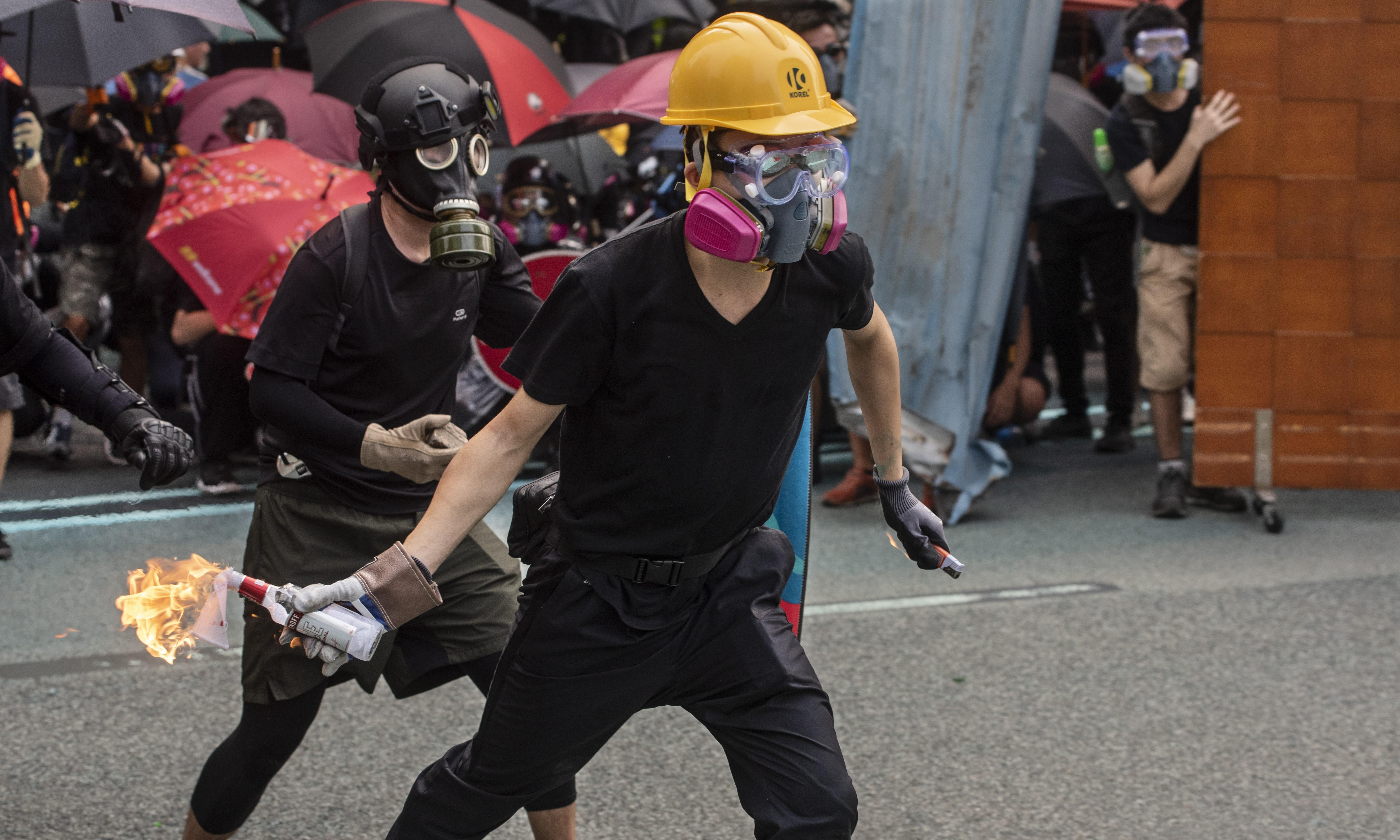 Arrests and rising tension as Hong Kong prepares for protests on China's national day