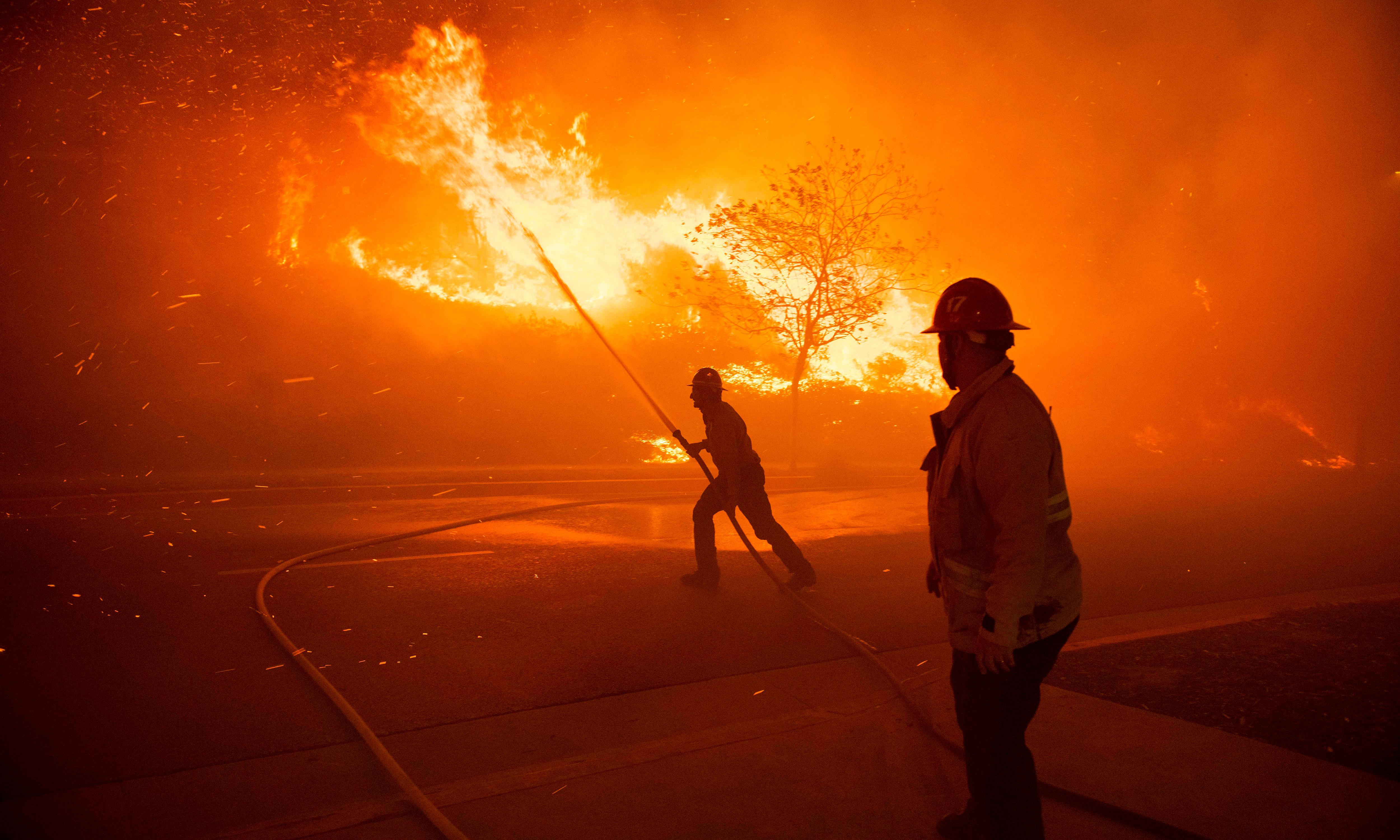 California wildfire spreads as fears mount over further power shutoffs