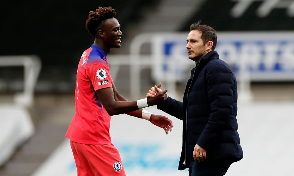 Tammy Abraham celebrates Chelsea's win with his manager Frank Lampard after the final whistle.