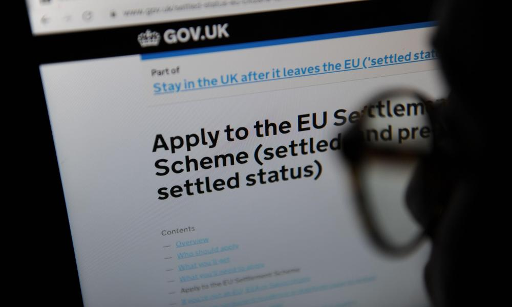 Advice on Applying to the EU Settlement Scheme seen through a magnifying glass on the UK government website2APGR0G Advice on Applying to the EU Settlement Scheme seen through a magnifying glass on the UK government website