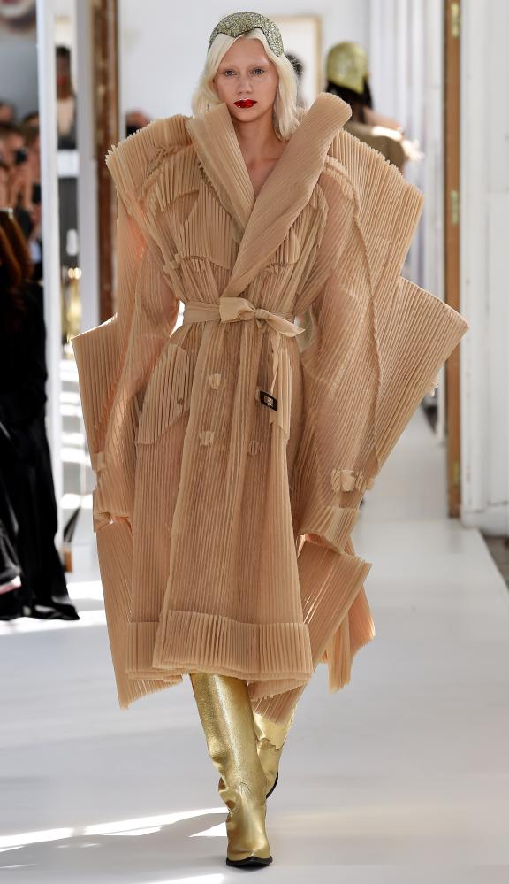 Model Lidia Judickaite in pleated trenchat Margiela.