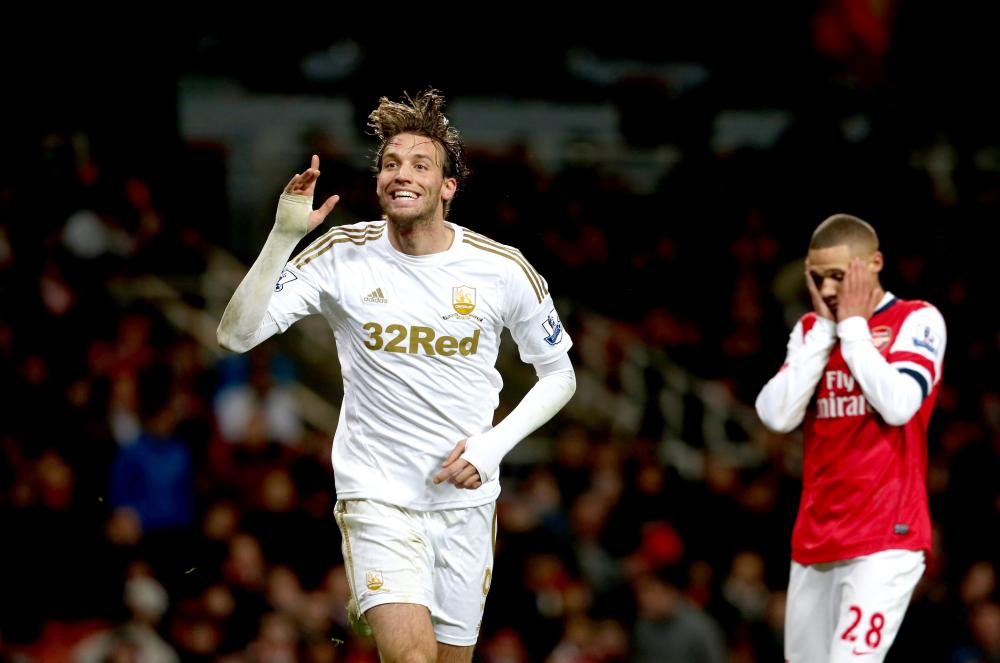 Michu celebrates after scoring against Arsenal in 2012.