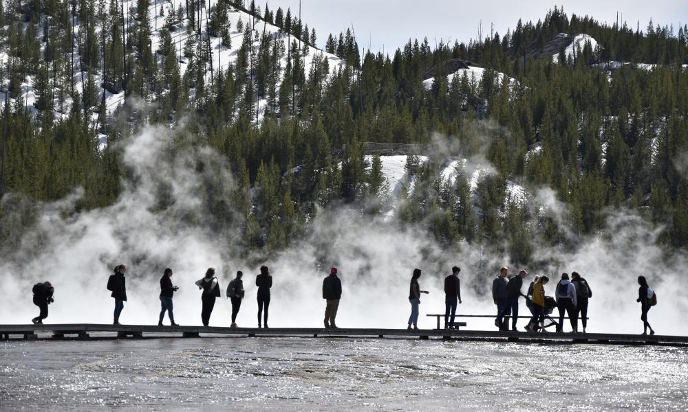 Visitors at Grand Prismatic spring in Yellowstone, Wyoming, on 1 May 2021.