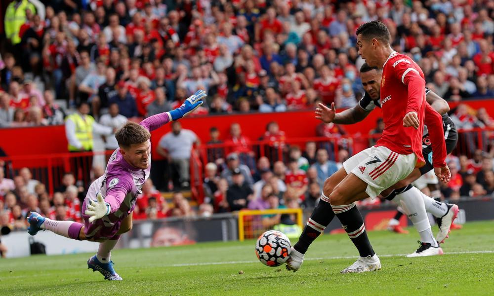 Manchester United's Cristiano Ronaldo scores past Newcastle keeper Freddie Woodman.