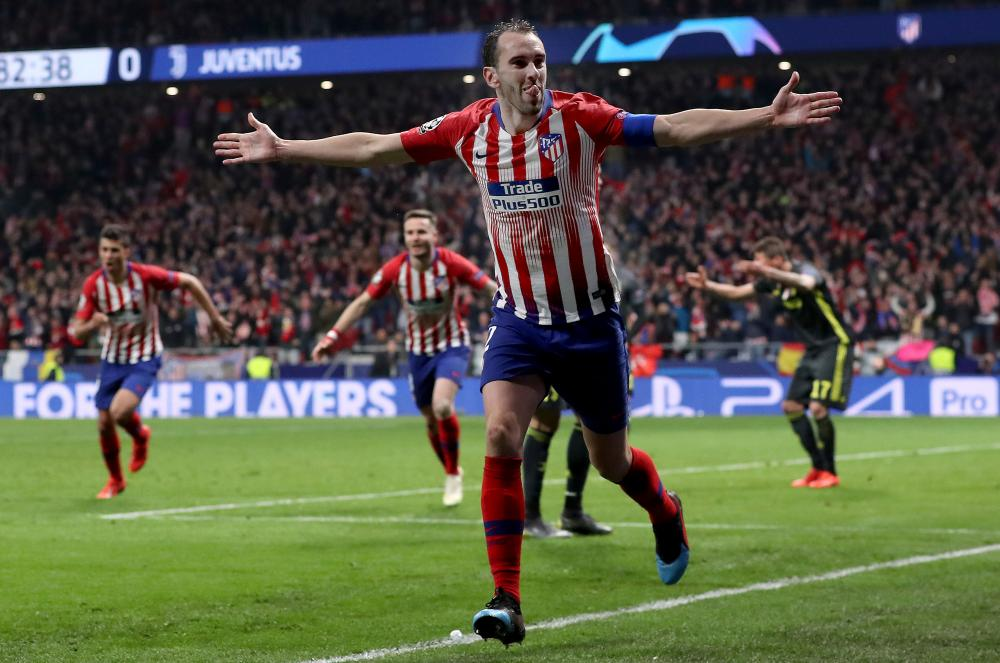 Diego Godin of Atletico Madrid celebrates after scoring his team's second goal .