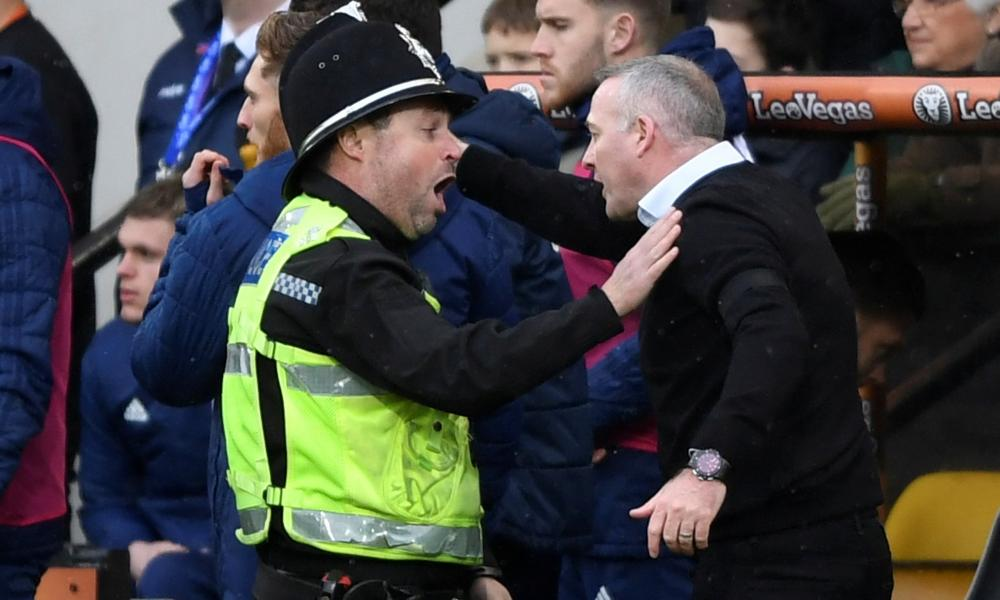 Ipswich manager Paul Lambert is talked to by a policeman.