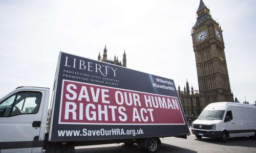 A van with a sign calling on the British government to 'Save Our Human Rights Act' is pictured as it is driven past the Houses of Parliament in central London on May 27, 2015. British Prime Minister David Cameron's Conservatives unveiled their programme for government Wednesday after a surprise clear win at this month's general election. AFP PHOTO / JACK TAYLORJACK TAYLOR/AFP/Getty Images