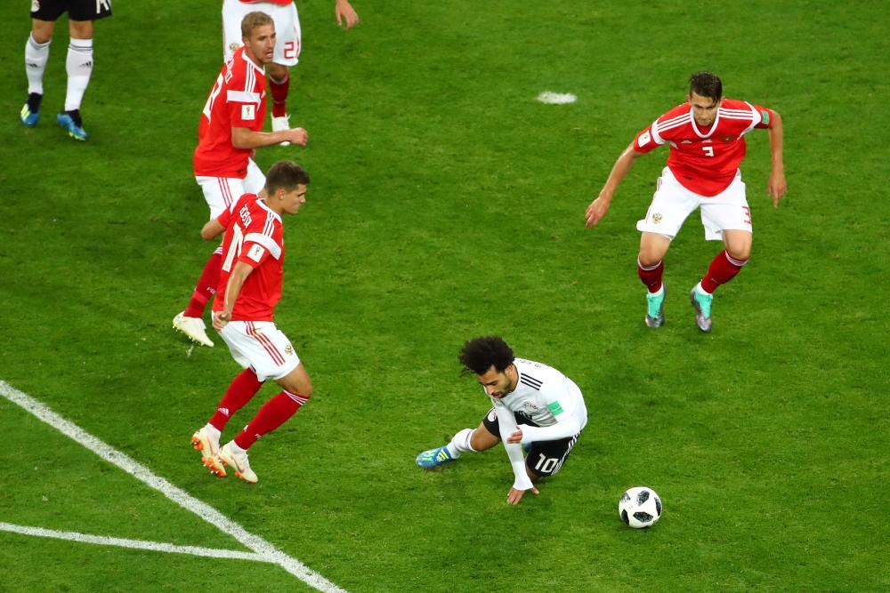 Salah goes down in the box.