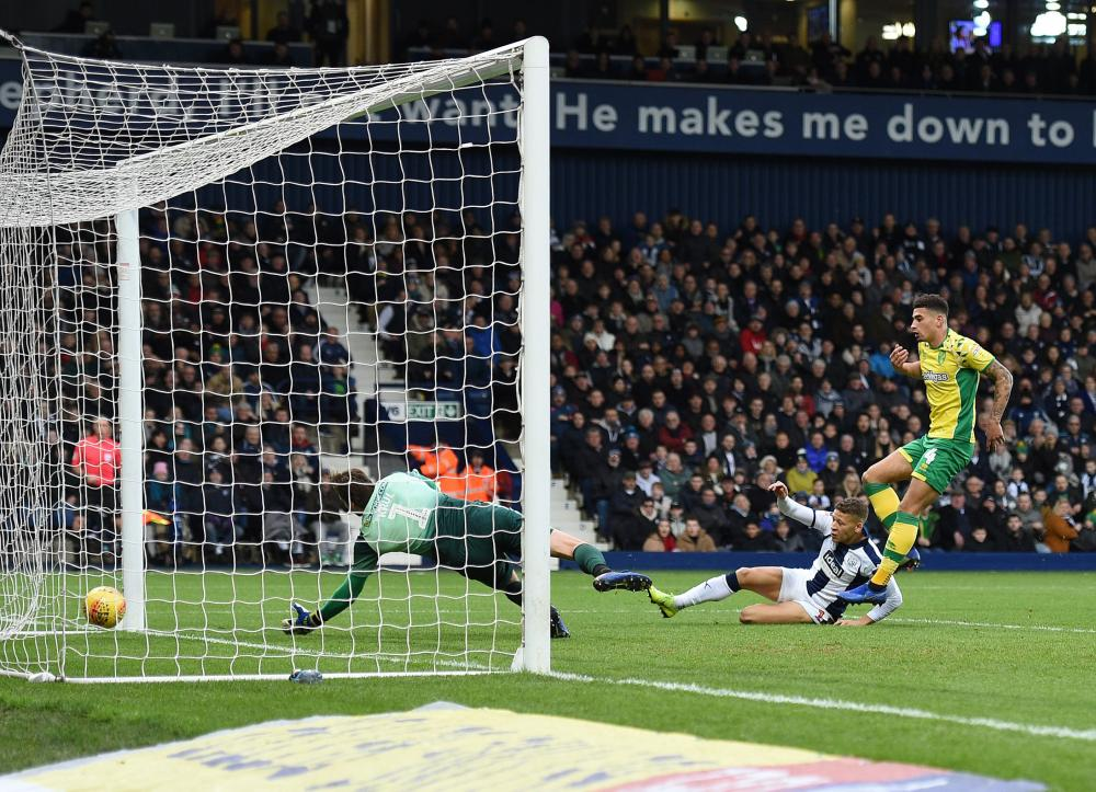 Dwight Gayle slides in to open the scoring.