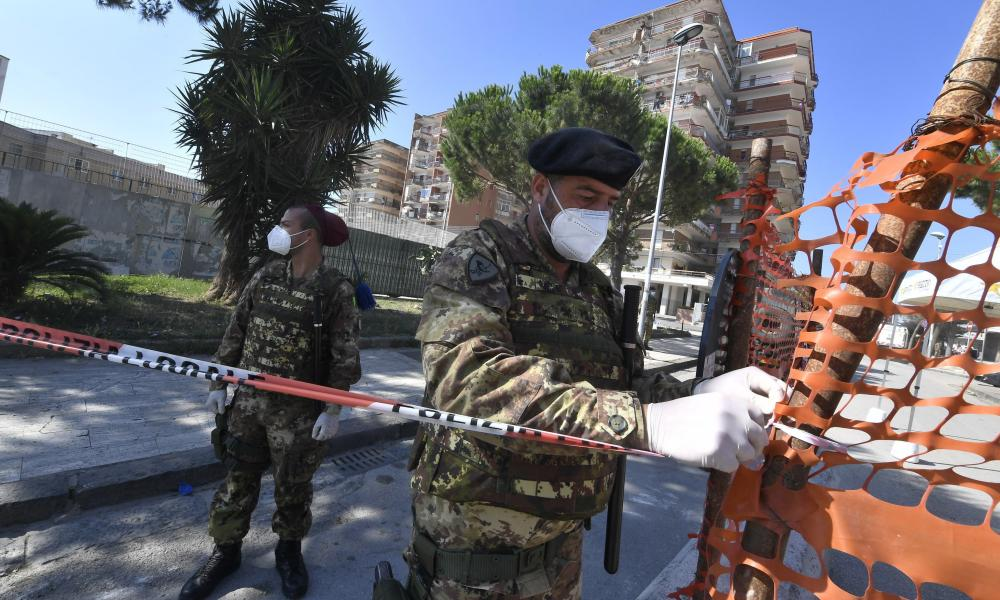 Soldiers secure a red zone, where new 49 cases of coronavirus infections were confirmed.