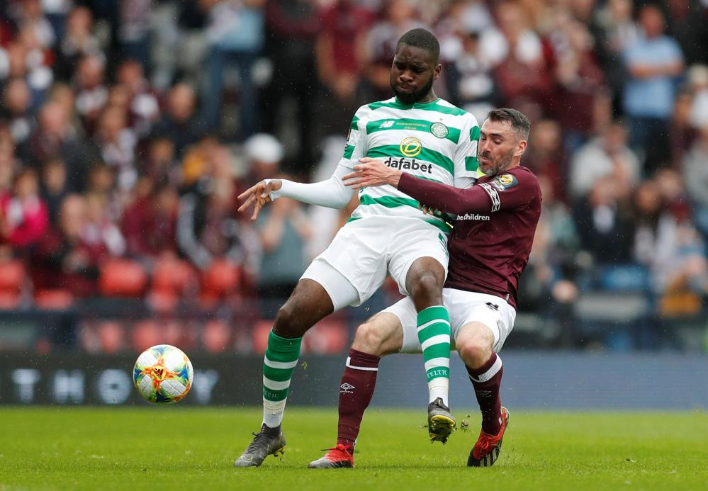 Odsonne Edouard in action with Hearts' Michael Smith.