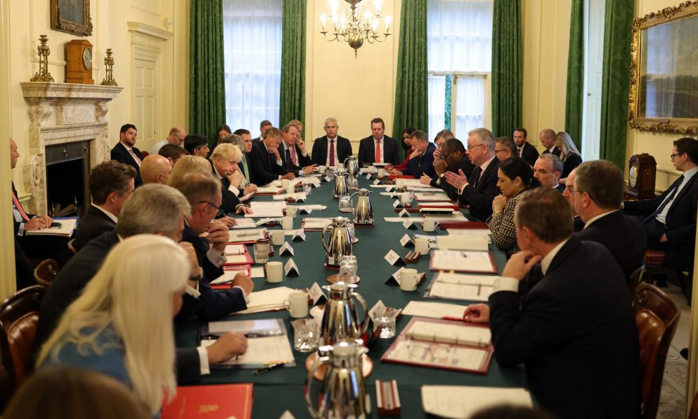 At least 27 senior members of government sat close together without face masks on Tuesday