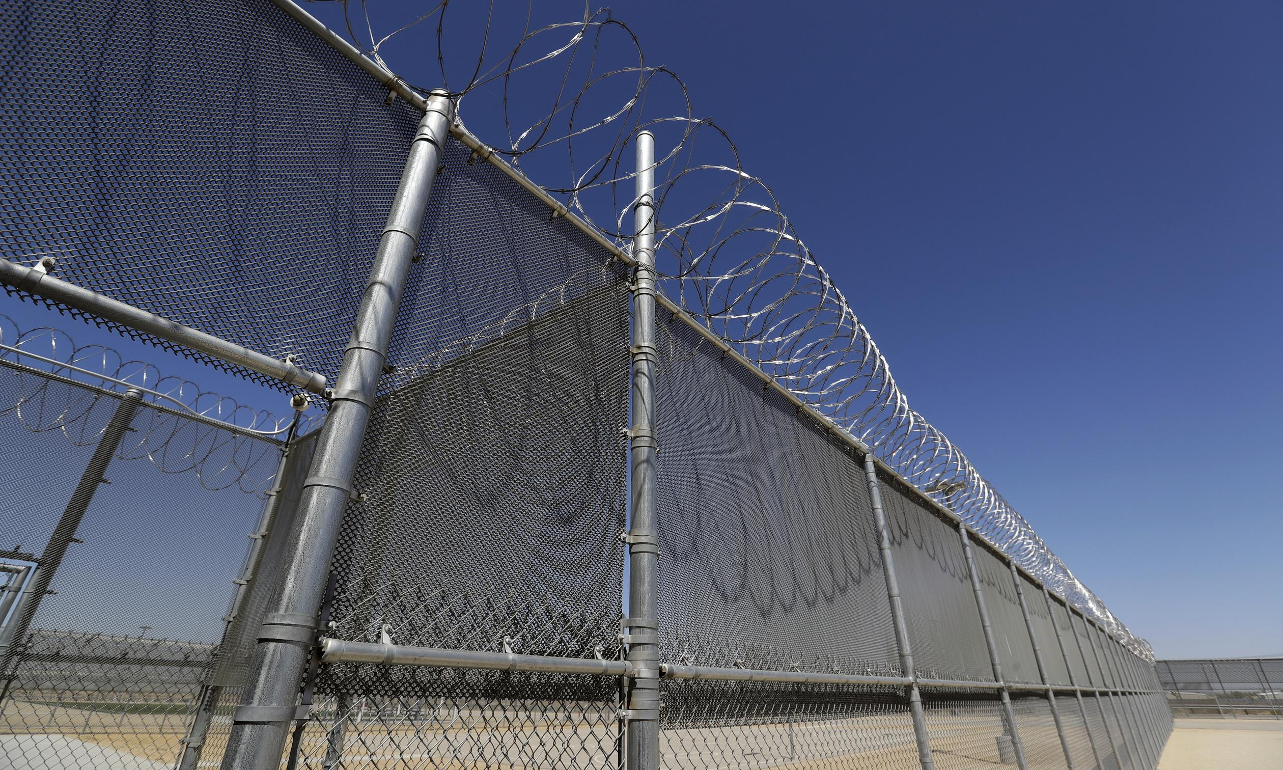 California governor signs ban on private prisons, setting up fight with Trump